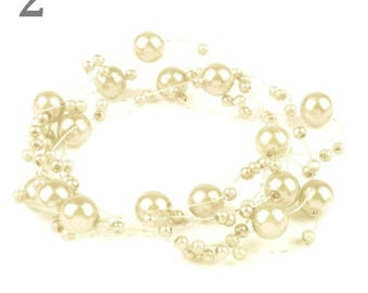 Wreath adorned with pearls ivory 130 cm