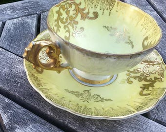 Royal Sealy China yellow and gold teacup and saucer set