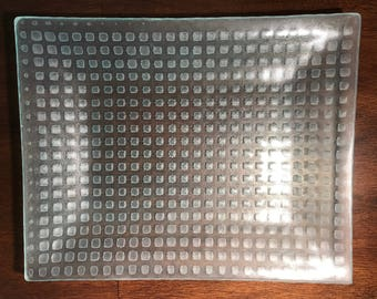"Platter - transparent fused glass with trapped square bubbles. 11.5"" long by 9.25"" wide and 1"" deep"