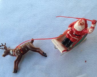 Vintage plastic Santa Claus Sleigh and one reindeer Christmas Decoration