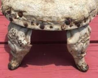 Antique - Really Old Antique Foot Stool . Cast Iron Bathtub Legs and  Antique Carbide of Calcium Lid attached to bottom side.
