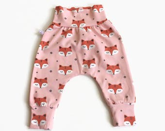 Pink baby harem pants with sleepy foxes. Pants with same fabric waistband and cuffs. Comfortable toddler pants. Jersey knit fabric.