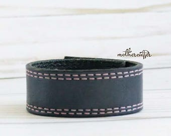 CUSTOM HANDSTAMPED narrow black leather cuff with pink stitching by mothercuffer