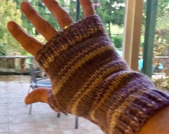 Hand knitted ladies fingerless gloves. Mixed colours but predominantly lilac.