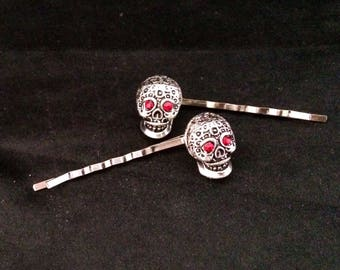 Set Of 2 Silver Metal Hair Pins With Silver Day Of The Dead Style Skulls With Sparkling Red Jeweled Eyes