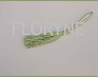 Tassel pendant in green thread