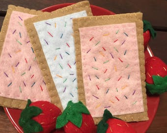 Poptarts. Felt food. Felt toaster pastry. Play food. Felt poptarts. Sprinkles. Strawberry. Icing.