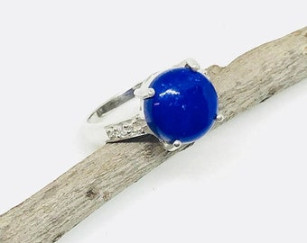 10% Lapis lazuli and white topaz  ring set in Sterling silver 925. Size- 8 1/2. Natural authentic lapis stone- 12mm round.