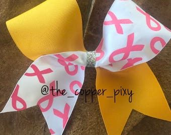 Pink awareness cheer bow with yellow TicToc