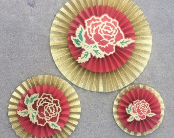 3 red and gold layered rosette with rose centers pinwheel paper rosette paper fan backdrop