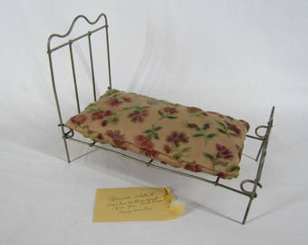 Antique folding metal doll bed with handmade mattress dated 1910