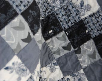 Small grey, white and black quilt