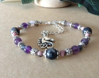 Silver, charm and natural stones bracelet
