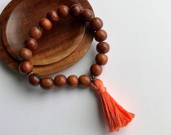 Wood Bead with Orange Tassel