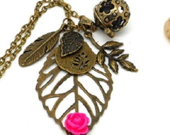 A scent! Necklace has perfume leaf, rose flower charms and co.