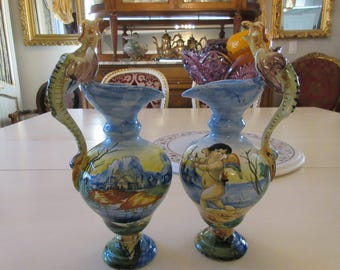 PAIR OF PITCHERS with Wyrm Handles and Cupids