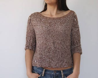 Silk sweater and its mother of Pearl buttons