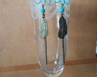 "Long ""flowers and feathers"" earrings"