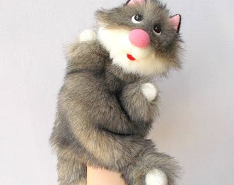 Fluffy kitty. Bibabo. Toy on hand. Marionette. Toy glove. Puppet theatre.