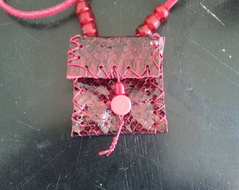 red snakeskin medicine bag