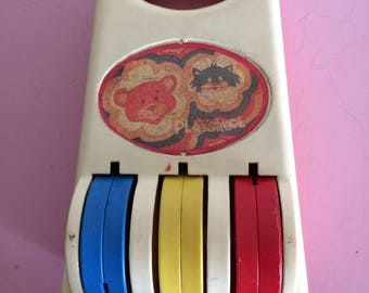 Vintage Playskool Music Instrument Roller Chimes in Orange and White