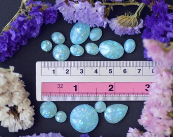 Set of 14 iridescent resin cabochons (Glow in the dark)