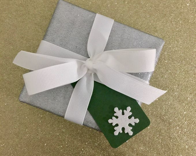 Add gift wrap to my packages, silver sparkle paper with white ribbon and gift tag in either red, green or white