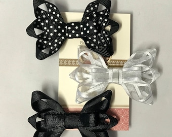 Trio of bow clips