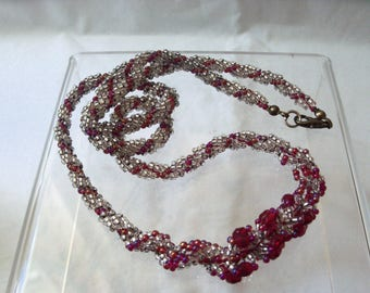 Pretty red and clear glass seed bead twisted strand necklace