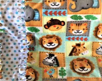 WE've Gotta ZOO! handmade fleece blanket designed by JAX. A Zoo Animal themed throw with extremely soft fabric perfect gift for little ones!