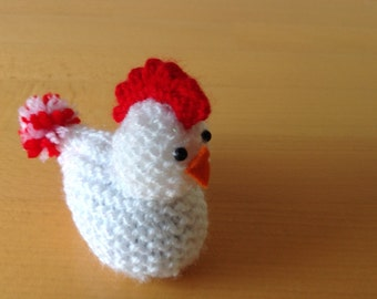 A hand knitted sparkly rooster guarding his Cadbury's creme egg.