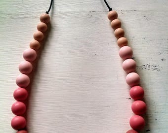 Silicone teething necklace- Pinky, FREE SHIPPING to Uk discounted elsewhere