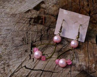 Bronze drop earrings and pink beads