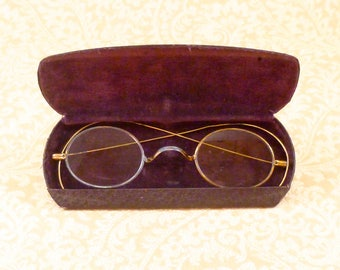 Antique wire-rimmed spectacles with case