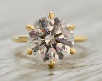 Round Brilliant in a Six Prong Trellis Cathedral Solitaire Engagement Ring in Yellow
