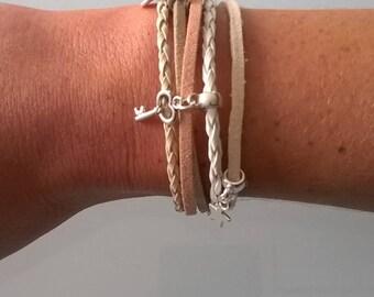 Multiple threads with beige/cream magnet clasp bracelet