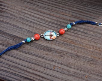 Navy blue corded bracelet with dragonfly charm, teal, silver and coral beads