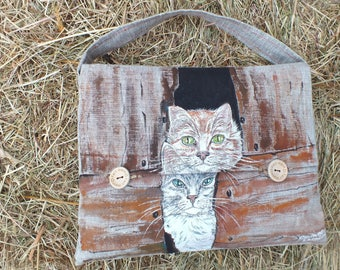 on a cream/beige linen tote bag. two great cats painted