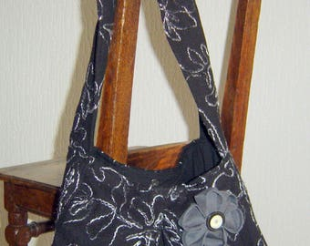 Black bag made of wool and grey stitching