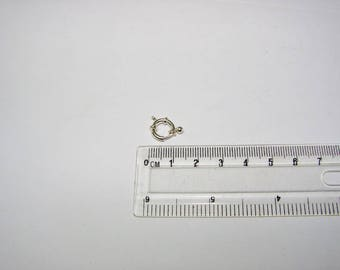 Clasp buoy 09.00 silver mm, round and spring. Silver first title