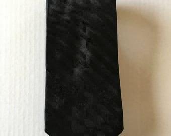 Black Herringbone Ralph Lauren Chaps tie. %100 Silk