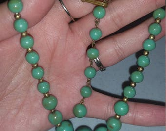 Green and gold tone beaded necklace