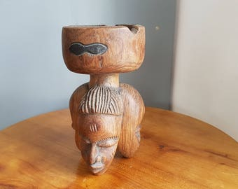 Carved wood ashtray. African craft. Wood sculpture.