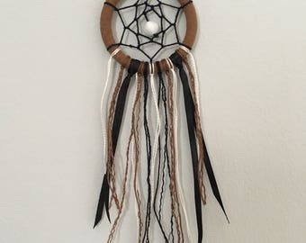 Mini Dreamcatcher in the Colours Black, White and Brown with a White Bead in the Centre.