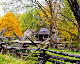 Rustic cabin with fall color. Split rail fence landscape. New Salem Il. Abraham Lincoln reconstructed village.