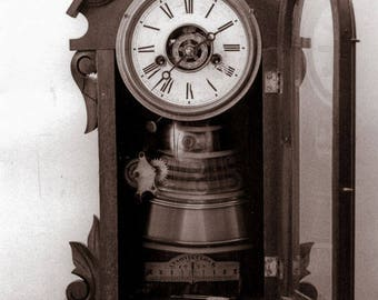 Old McBeth's Clock has a ghostly feel as a time exposure while the pendulum swings in the 19th century antique. Photo taken on film 1970's.