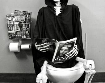 Grim on toilet