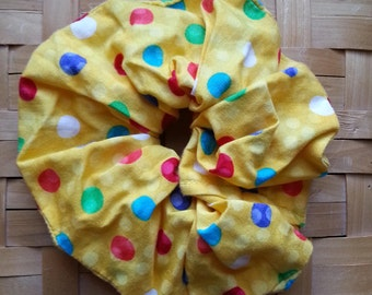 Yellow hair scrunchie with polka dots