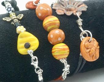 Set of 3 Womans Leather Bracelets, Boho Fun Cord Jewelry, Orange Bee Bracelet Black Layering Bracelet, Multi Strand Stacking Bracelets, Gift