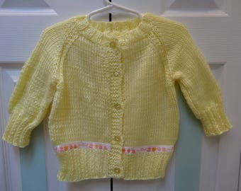 BABY YELLOW SWEATER, Cardigan style, 5 buttons, size 6 to 9 months, satin ribbon states[its a girl],soft ,light weight acrylic yarn